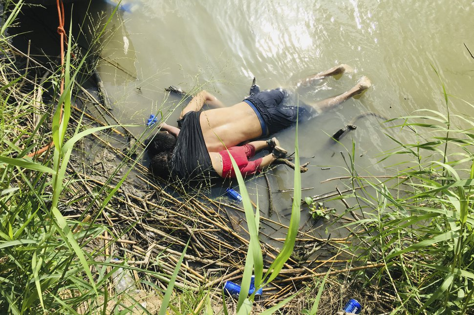 (Julia Le Duc | AP) The bodies of Salvadoran migrant Oscar Alberto Martínez Ramírez and his nearly 2-year-old daughter Valeria lie on the bank of the Rio Grande in Matamoros, Mexico, Monday, June 24, 2019, after they drowned trying to cross the river to Brownsville, Texas. Martinez' wife, Tania told Mexican authorities she watched her husband and child disappear in the strong current.