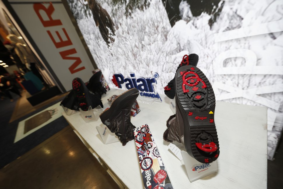 A display of Pajar shoes with built-in crampons is on display at the opening of the Outdoor Retailers and Snow Show in the Colorado Convention Center, Thursday, Jan. 25, 2018, in Denver. Three floors of all the latest products for outdoor use makes the event the largest U.S. trade show for the outdoor and winter sports industries that represent $887 billion in sales. (AP Photo/David Zalubowski)