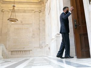 (Stefani Reynolds | The New York Times) Sen. Mitt Romney, R-Utah, enters a Senate Republican Policy luncheon at the Russell Senate Office Building in Washington on Tuesday, May 11, 2021. Romney and Sen. Kyrsten Sinema, D-Ariz., have reached a compromise plan to boost the minimum wage.