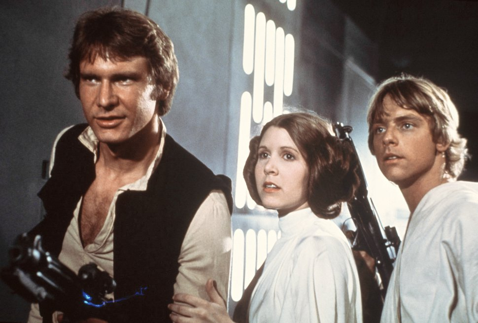 This publicity film image provided by 20th Century-Fox Film Corporation shows, from left, Harrison Ford as Han Solo, Carrie Fisher as Princess Leia Organa and Mark Hamill as Luke Skywalker in a scene from the