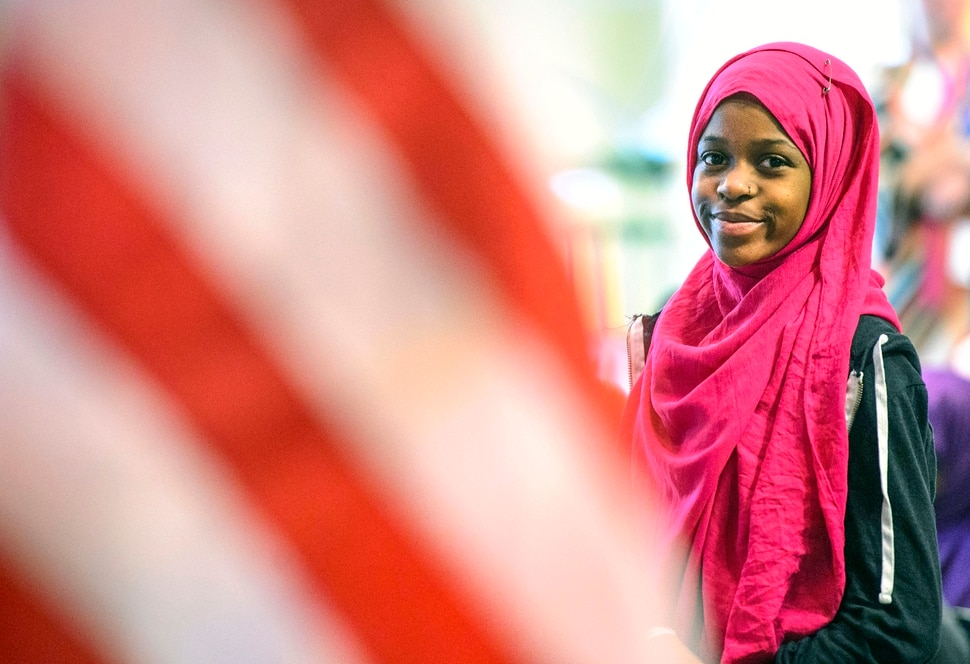 (Steve Griffin   The Salt Lake Tribune) Muslima Mohamed, who is originally from Kenya, smiles as she becomes a U.S. citizen as children, ages 7 to 14, had a very special day at Discovery Gateway: the ChildrenÕs Museum of Utah Monday when they received citizenship certificates from the Salt Lake County and U.S. Citizenship and Immigration Services during the ceremony in Salt Lake City Monday August 7, 2017.