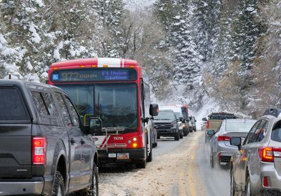 (Leah Hogsten | The Salt Lake Tribune)  Unified Police Department officers held up canyon traffic for a hour and a half as avalanche mitigation efforts were underway at Carter Fork, Mineral Slab and Rock House areas of Big Cottonwood Canyon, Feb 16, 2021.