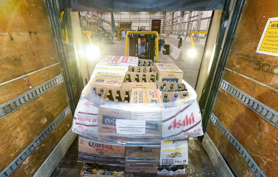 (Francisco Kjolseth | The Salt Lake Tribune) Operator Braeden Adamson maneuvers a fork lift as the DABC delivers 275 cases of beer on three pallets to the new food digester in North Salt Lake on Friday, Dec. 13, 2019. The state can no longer sell the beer — all between 4% and 5% ABV — because it can't compete with privately-owned grocery and convenience stores which started selling the higher alcohol brews on Nov. 1.