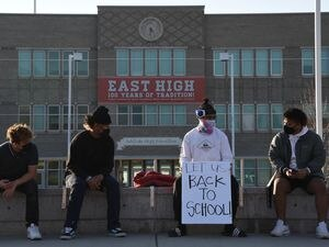 (Francisco Kjolseth  | The Salt Lake Tribune) East High students join the protest outside their school in Salt Lake City on Monday, Dec. 7, 2020, in response to more students failing this fall with classes entirely online due to the coronavirus pandemic.