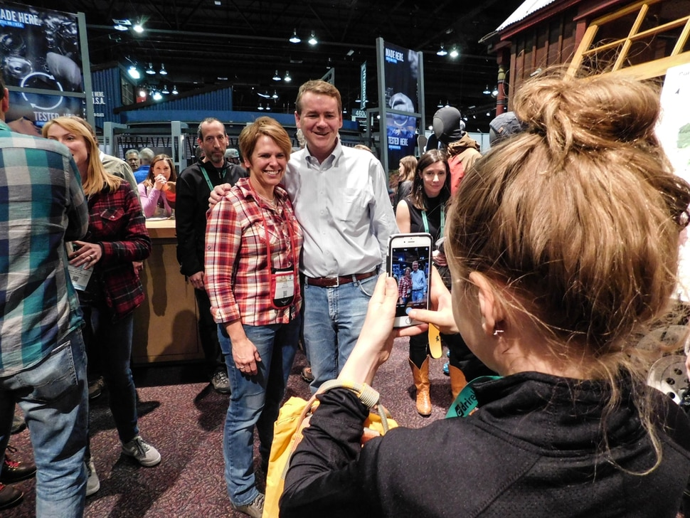 (Erin Alberty | The Salt Lake Tribune) U.S. Sen. Michael Bennet, D-Colorado, poses with a fan during a public lands discussion at the Outdoor Retailer show Jan. 27, 2018 at the Colorado Convention Center in Denver.
