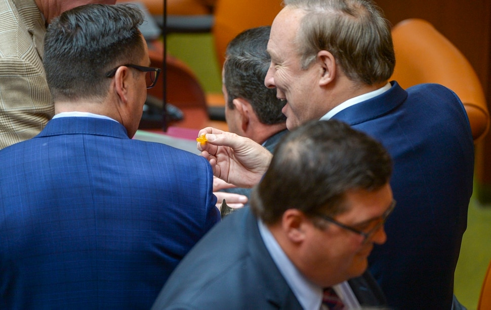 (Leah Hogsten | The Salt Lake Tribune) Outgoing State Sen. Jim Dabakis offers House Speaker Greg Hughes a candy gummy bear. Debakis who jokingly offered Utah House members candy gummy bears that look similar to marijuana-infused edibles. Utah legislators voted to change the Utah Medical Cannabis Act, the bill that officials, Prop 2 opponents and medical marijuana advocates crafted and pitched as a compromise. On Monday, Dec. 2, 2018 during the special session, lawmakers overhauled the medical cannabis distribution system, reduces the number of medical marijuana outlets, prohibits edibles for gelatin cubes instead and changes the list of illnesses that qualify for cannabis treatments.