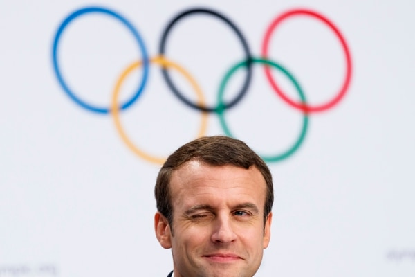 French President Emmanuel Macron, winks during a press conference after the presentation of Paris 2024 Candidate City Briefing for International Olympic Committee (IOC) Members, at the SwissTech Convention Centre, in Lausanne, Switzerland, Tuesday, July 11, 2017. (Jean-Christophe Bott/Keystone via AP)