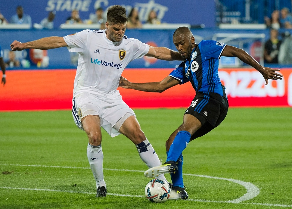Montreal Impact's Anthony Jackson-Hamel, right, challenges Real Salt Lake's David Horst during the second half of an MLS soccer match in Montreal, Saturday, Aug. 19, 2017. (Graham Hughes/The Canadian Press via AP)