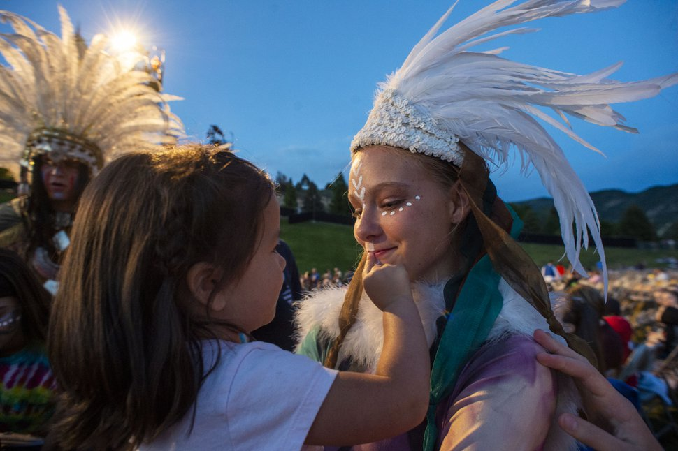 (Rick Egan | The Salt Lake Tribune) Catalina Pickering, 3, from Saratoga Springs is is fascinated with the costume worn by 15-year-old Bethany Christensen, a Lamanite dancer, as the performers mix with the audience, before the Mormon Miracle Pageant Wednesday, June 12, 2019. The final run for the pageant continues through Saturday, June 22.