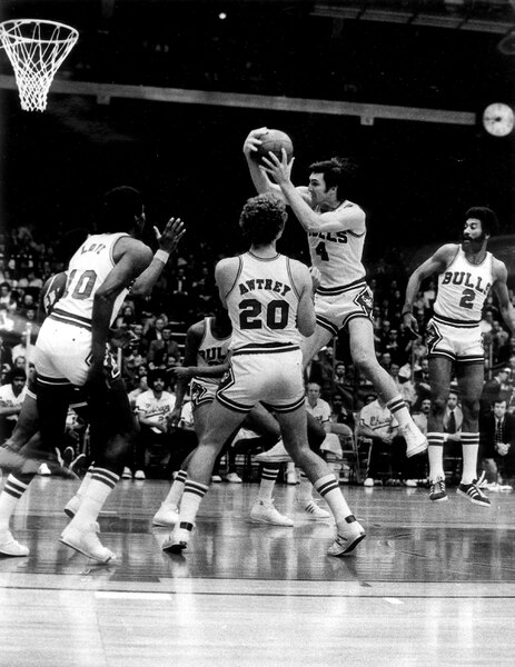 (Phil Mascione | Chicago Tribune file photo) Jerry Sloan pulls down a rebound in an undated photo.