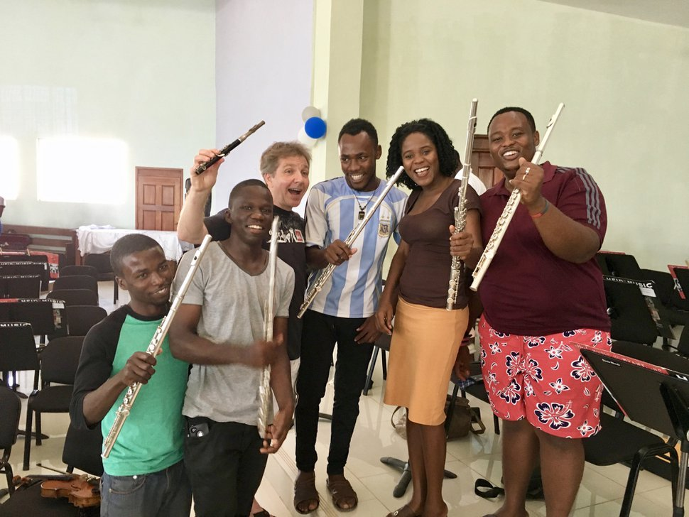 Yuki MacQueen   Courtesy Utah Symphony music director Thierry Fischer, who was a professional flutist before switching to conducting, poses with the flutists of the student orchestra during a weeklong teaching trip to Jacmel, Haiti.