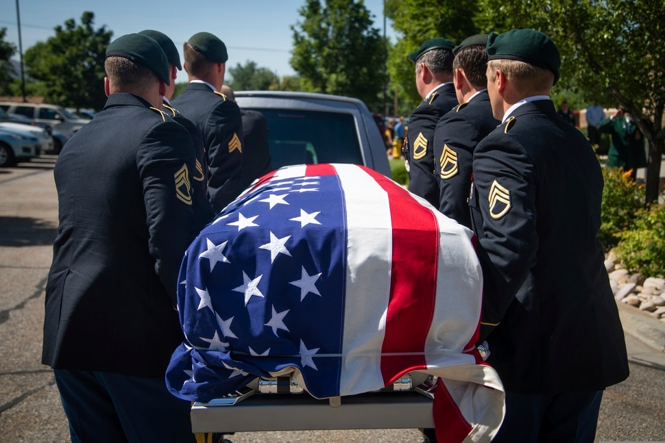 (Ben Dorger | Standard-Examiner via AP) Military personnel carry the remains of Army Sgt. 1st Class Elliott Robbins in a funeral procession on Thursday, July 18, 2019. Robbins died in a non-combat incident on June 30 while serving in Afghanistan.