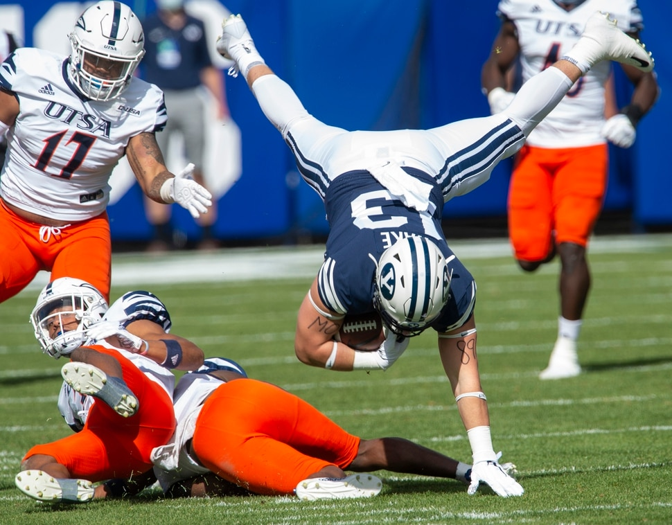 (Rick Egan   The Salt Lake Tribune) Brigham Young Cougars tight end Masen Wake (13) leaps over the top of UTSA Roadrunners cornerback Corey Mayfield Jr. (26) in football action between the Brigham Young Cougars and the UTSA Roadrunners, at Lavell Edwards stadium, Saturday, Oct. 10, 2020.