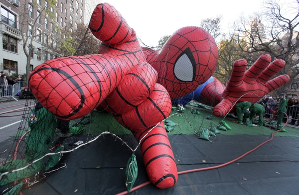 (AP Photo/Richard Drew, File) In this Nov. 21, 2012, photo, workers inflate the Spider-Man balloon for the annual Macy's Thanksgiving Day Parade in New York.