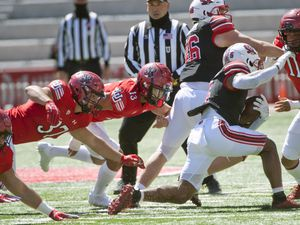 (Ed Kosmicki | Special to The Tribune) The red team defensemen close in on black team running back T J Pledger during the annual spring football game at the University of Utah, 17 April 2021.