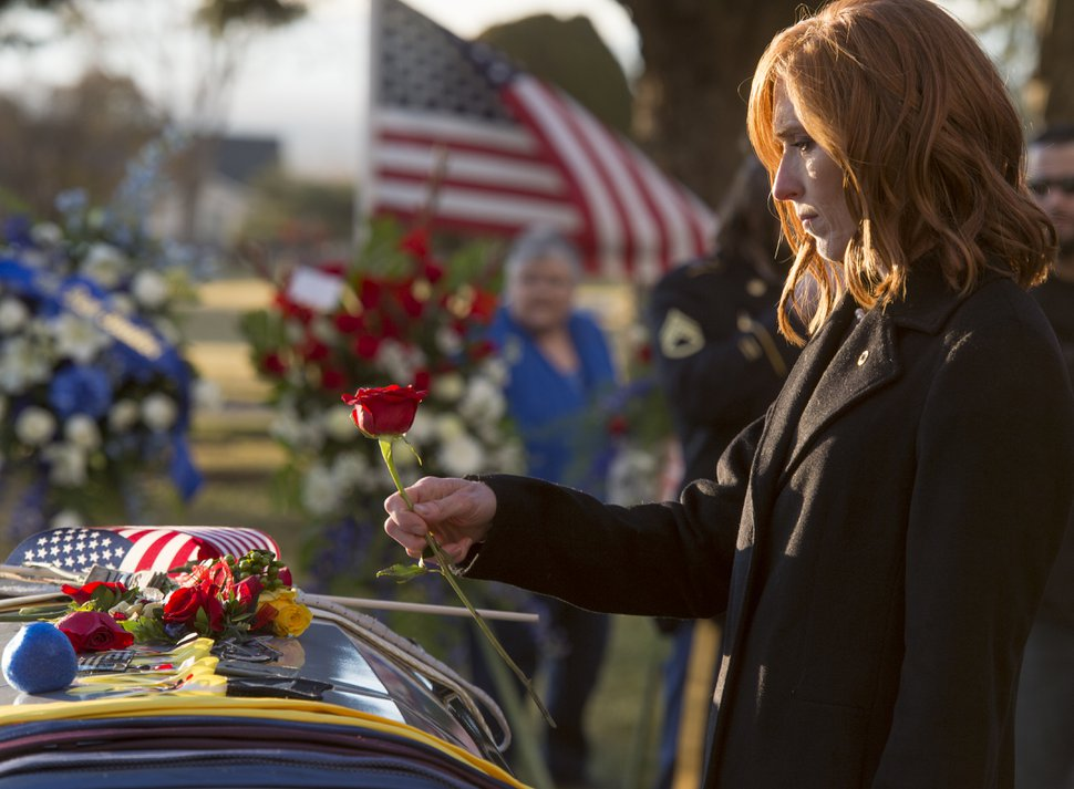 (Rick Egan | The Salt Lake Tribune) Jennie Taylor places a rose on the casket of her husband, National Guard Maj. Brent Taylor, after the graveside services at Ben Lomond Cemetery, in North Ogden, Saturday, Nov. 17, 2018.