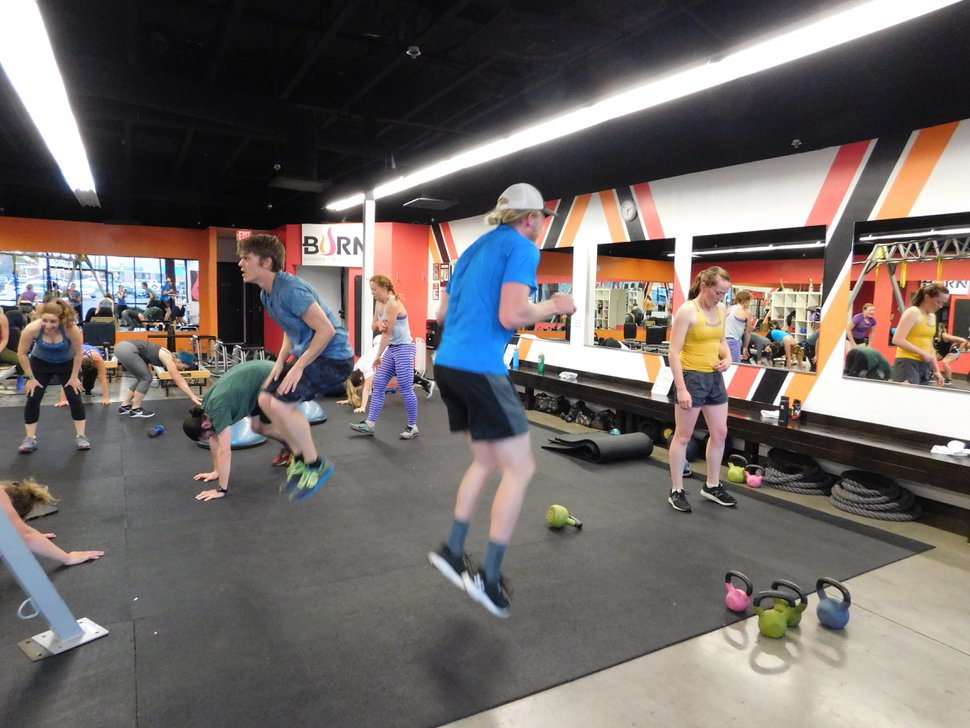 (Erin Alberty   The Salt Lake Tribune) Students jump and tuck their feet during a ski conditioning class Nov. 2, 2017 at Burn, a gym in Salt Lake City.