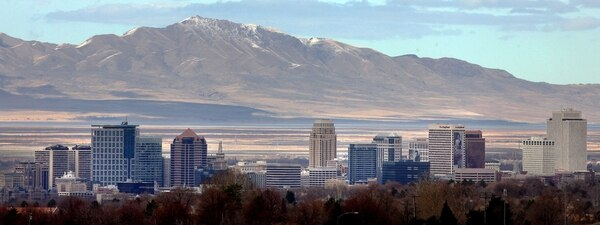 (Steve Griffin | Tribune File Photo) Antelope Island rises above the Salt Lake City skyline as a weekend storm system brought snow to the Wasatch Front Monday, March 19, 2012.