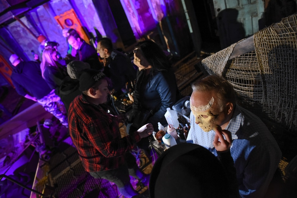 (Francisco Kjolseth | The Salt Lake Tribune) Local politicians fall prey to the zombie apocalypse at the Fear Factory on Thursday, Oct. 12, 2017, for a special event to raise awareness of the Utah Food Bank and kick start donations. Participating politicians included: Salt Lake County Mayor Ben McAdams, Utah House Speaker Greg Hughes, Salt Lake County Councilmember Jenny Wilson, State Senators Jim Dabakis and Karen Mayne, and Utah House member Angela Romero.