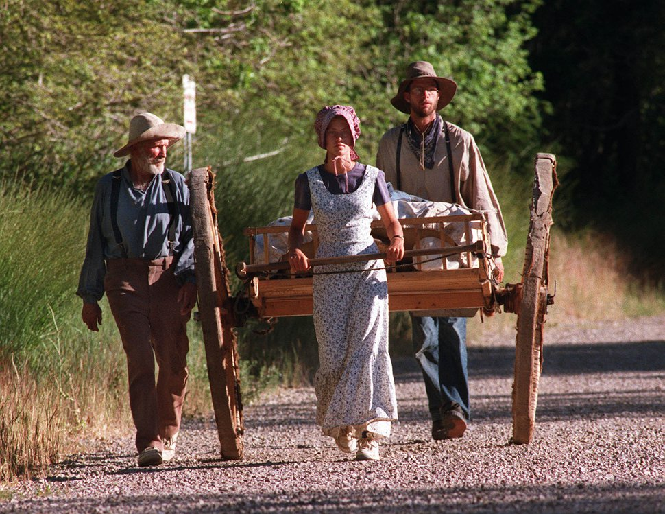 (Steve Griffin | Tribune File Photo) Montell Seely, his daughter Janell and son Mark make their way down Emigration Canyon as they completed their trek from winter quarters during the 1997 re-enactment trek to Utah.