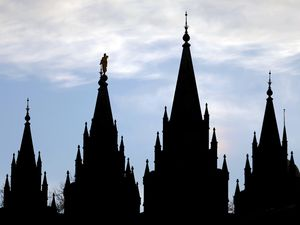 (Rick Bowmer | AP file photo) A silhoutte of the Salt Lake Temple of The Church of Jesus Christ of Latter-day Saints on Jan. 3, 2018. Membership in The Church of Jesus Christ of Latter-day Saints has dropped for the third straight year in the  faith's home base of Salt Lake County.