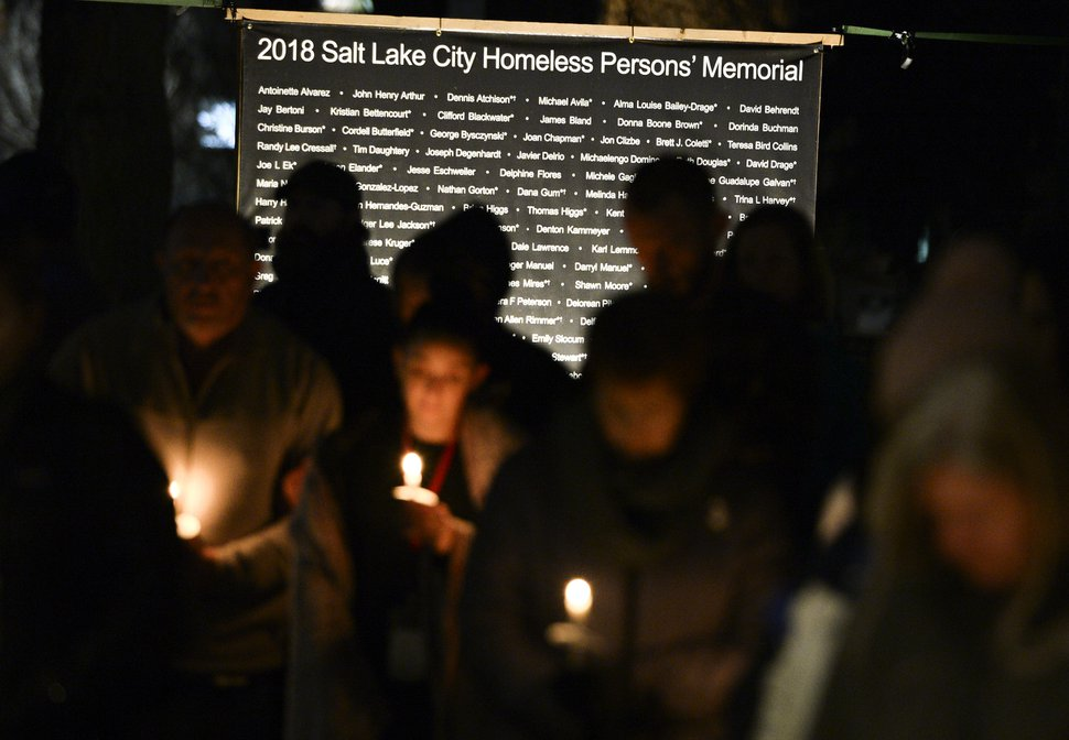 (Leah Hogsten | Tribune file photo) Names of the 121 homeless people who lost their lives were read aloud to remember and honor homeless persons who died in Salt Lake City in 2018 during the Homeless Persons' Memorial Day Candlelight Vigil, Dec. 20, 2018 at Pioneer Park.