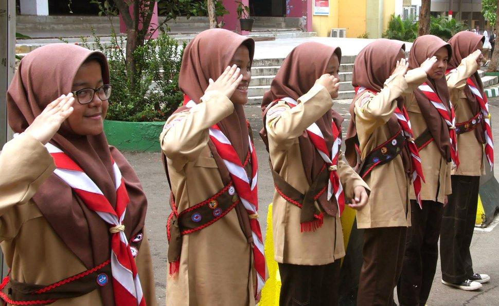 (Mike Stack | for The Salt Lake Tribune) Girl Scouts salute at Darunnajah Islamic Boarding School in Jakarta, Indonesia, in October 2017