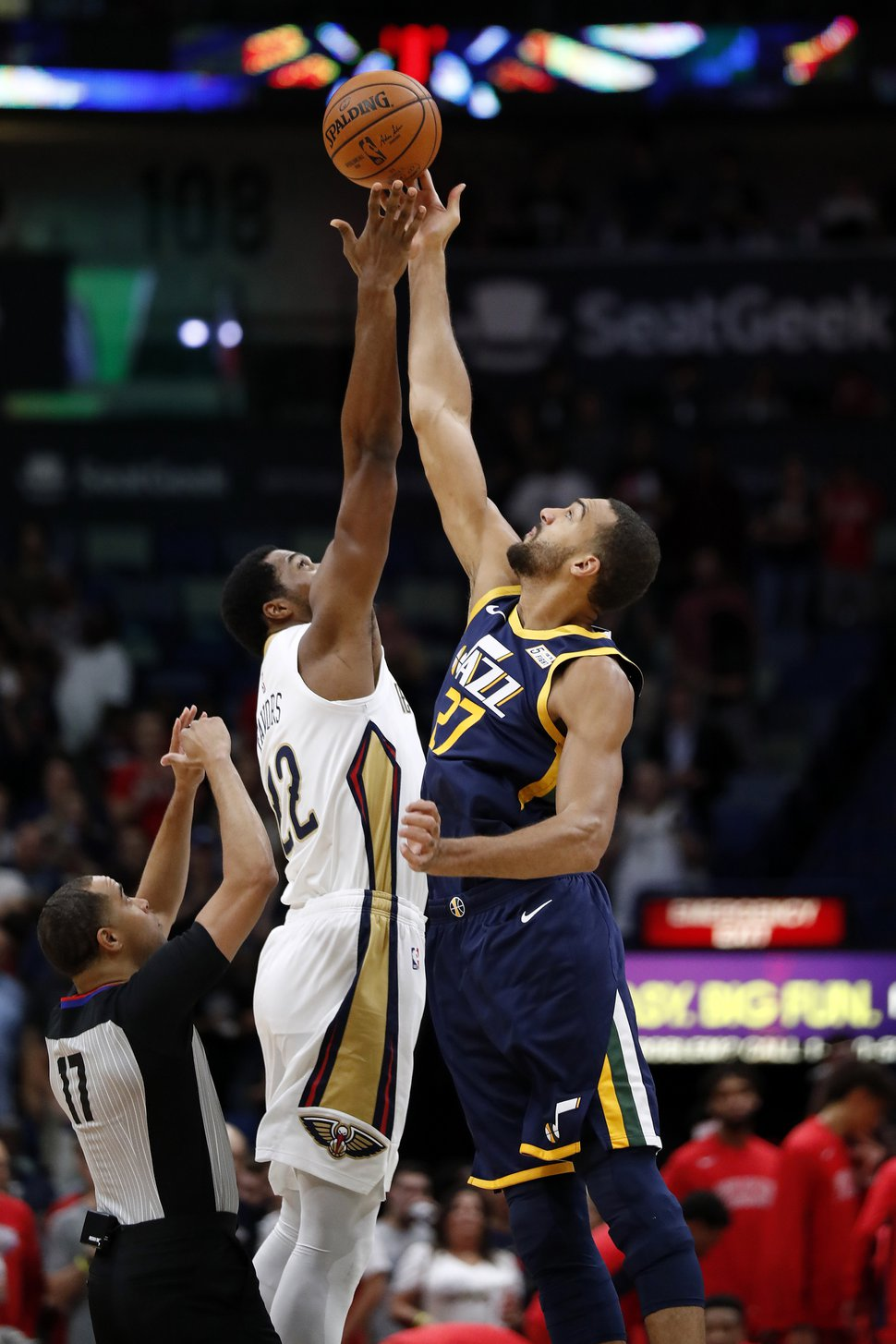 New Orleans Pelicans forward Derrick Favors (22) and Utah Jazz center Rudy Gobert (27) go up for the ball in the first half of a preseason NBA basketball game in New Orleans, Friday, Oct. 11, 2019. (AP Photo/Tyler Kaufman)