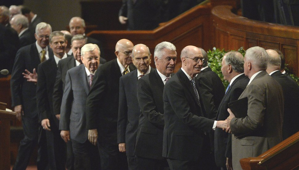(Al Hartmann | The Salt Lake Tribune) President Henry Eyring, first counselor to the First Presidency, fourth from right,, and President Dieter Uchtdorf, second counselor to the First Presidency, just behind, shake hands with the members of Qurom of the Twelve Apostles at concusion of the Sunday morning session of the LDS Church's 187th Semiannual General Conference in Salt Lake City on Sunday Oct. 1.