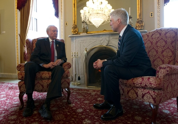 (Jose Luis Magana | AP Photo) Supreme Court Justice nominee Neil Gorsuch, right, meets with Sen. Orrin Hatch, R-Utah In Hatch's office on Capitol Hill in Washington, Wednesday, Feb. 1, 2017.