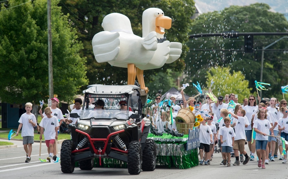 (Rick Egan | The Salt Lake Tribune) The Riverton Harvest Park Stake float Building Faith Through Pioneer Stories features crickets and a giant seagull, followed by kids with Future Missionary shirts, in the Days of 47 Youth Parade, Saturday, July 21, 2018.