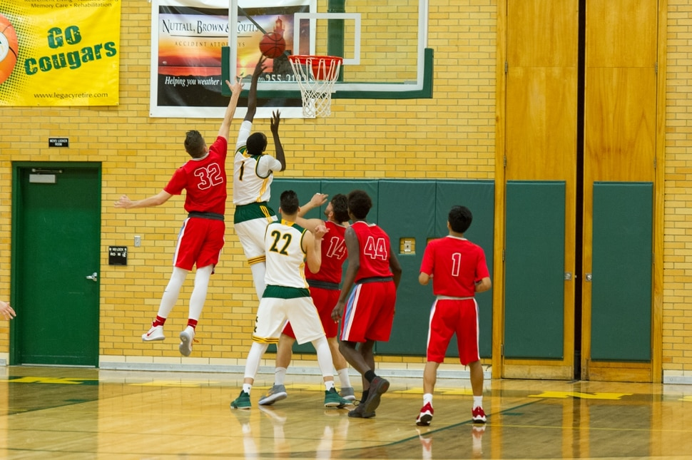 (Alex Gallivan | Special to the Tribune) Kearns Forward Majok Kuath (1) goes for the layup against Granger forward Anel Alagic (32) during game action at Kearns High Friday January 12, 2018