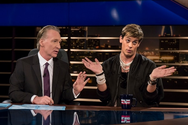 In this photo provided by HBO, host Bill Maher, left, listens to Breitbart News' Milo Yiannopoulos on HBO's