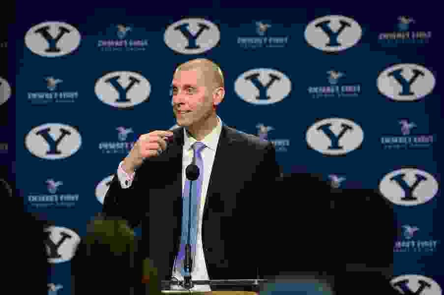 BYU's new basketball coach wants to play as many top teams as possible. He jokingly calls his scheduling plan 'pretty much just dumb.'