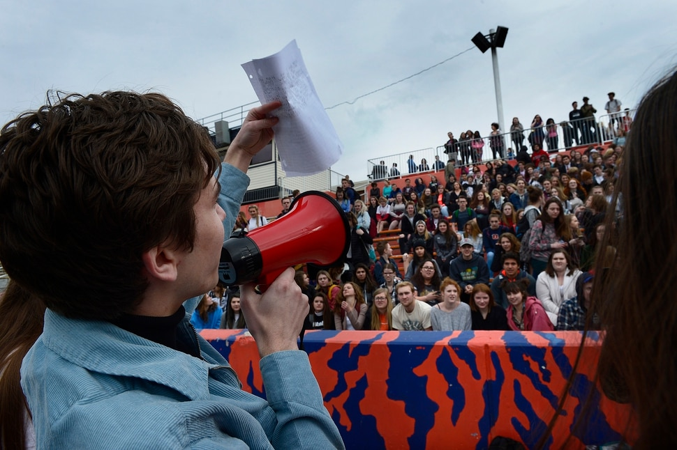 Scott Sommerdorf | The Salt Lake Tribune Student organizer Isaac Reese addresses the crowd of students who walked out of class at Brighton High and gathered in the football stadium. The students read aloud the names of each of the 17 students and staff killed at Marjory Stoneman Douglas High School, during their walkout at Brighton High School, Wednesday, March 14, 2018.