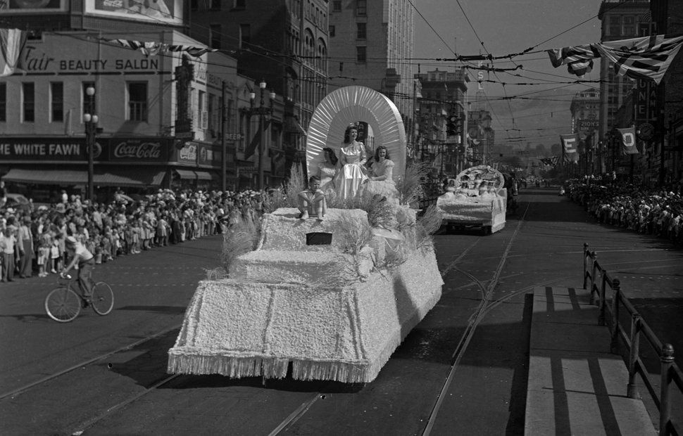 (Photo courtesy of Utah State History) Days of '47 Queen Marion Woodard and her attendants ride a float down Salt Lake City's Main Street in the 1945 Pioneer Day parade —held in the waning days of World War II. The photo was originally taken by a Salt Lake Tribune staff photographer.