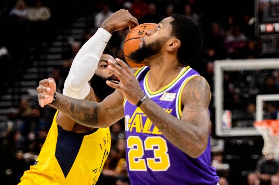 (Trent Nelson | The Salt Lake Tribune) Indiana Pacers guard Tyreke Evans (12) steals the ball from Utah Jazz forward Royce O'Neale (23). Utah Jazz v Indiana Pacers, NBA basketball at Vivint SmartHome Arena in Salt Lake City on Monday Nov. 26, 2018.