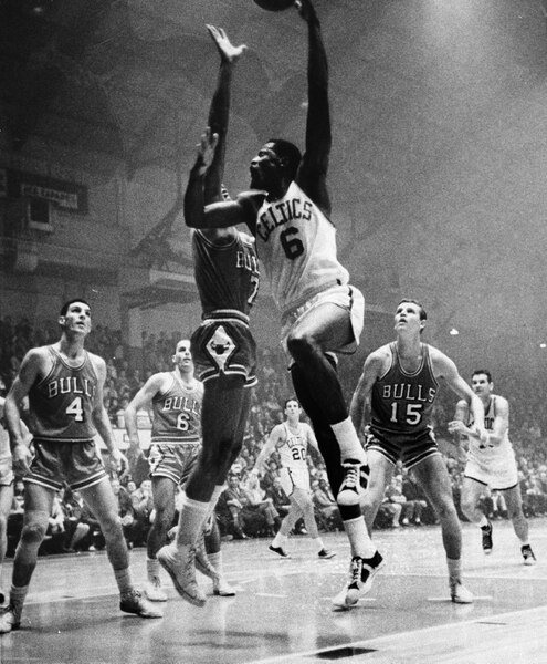 (J.D. Lamontagne | AP Photo )Player-coach Bill Russell (6) of the Boston Celtics sinks a hook shot against the Chicago Bulls at the Auditorium in Providence, R.I., Oct. 27, 1966. Jerry Sloan (4), Gerry Ward (6), Jim Washington (7) and Keith Erickson (15) all of the Bulls are in on the play. The Celtics won 123-100.