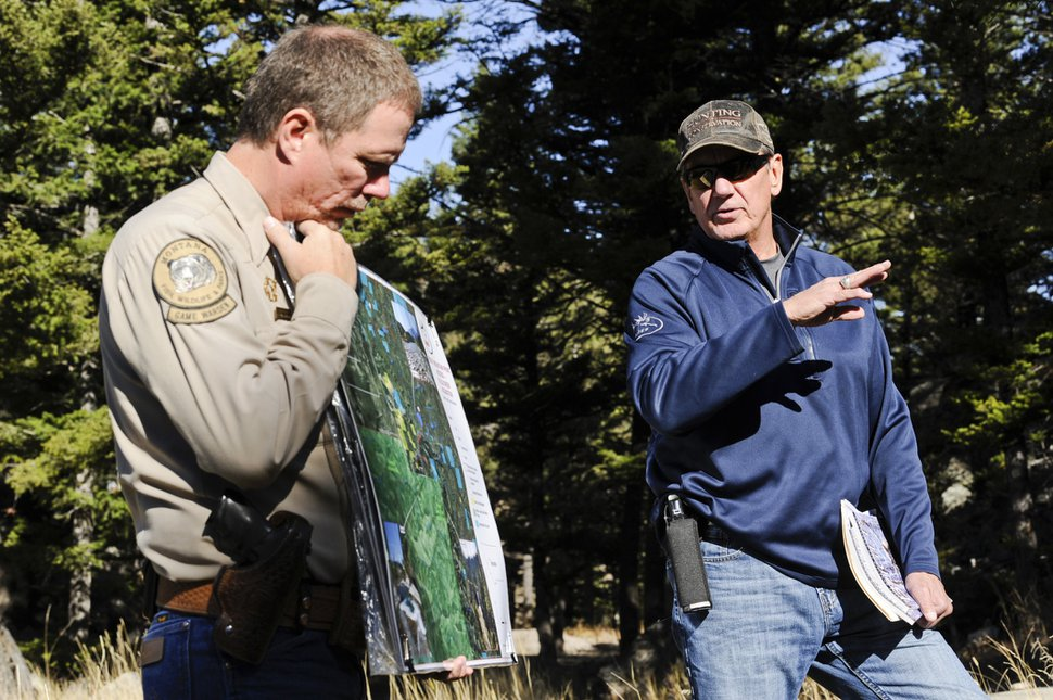 Montana Fish, Wildlife & Parks Game Warden Bryan Golie, left, and Mike Mueller with the Rocky Mountain Elk Foundation introduce the Barrett property and Fall Creek Vally during a tour on Oct. 19, 2018. Under a deal recently reached, and pending fundraising, the property could become the newest piece of the Helena-Lewis and Clark National Forest and open up access to about 26,000 acres of public land. (Thom Bridge/Independent Record via AP)