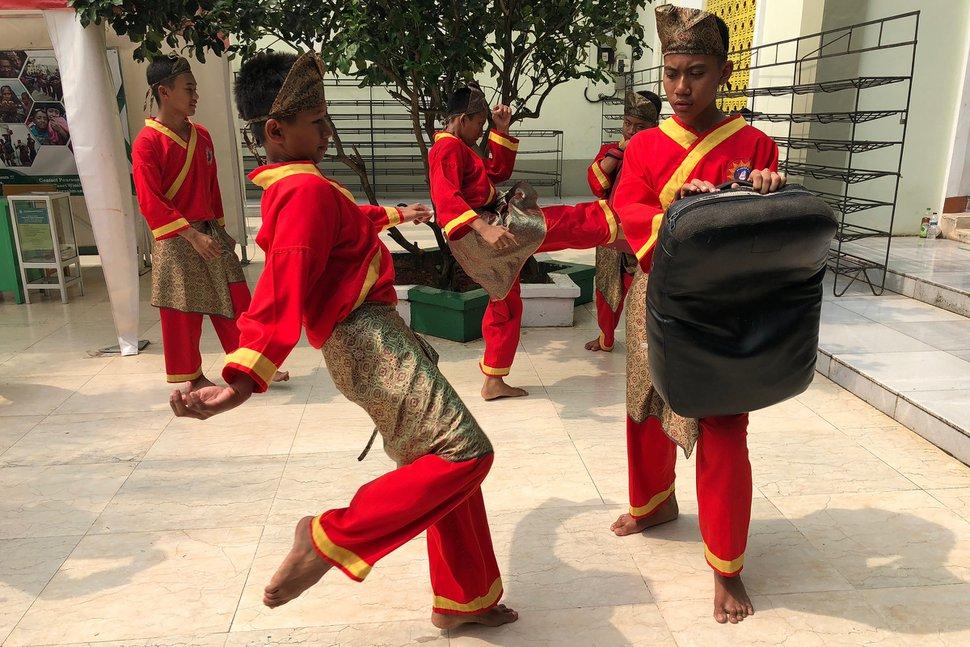(Mike Stack | for The Salt Lake Tribune) Boys practicing martial arts at Darunnajah Islamic Boarding School in Jakarta, Indonesia, in October 2017