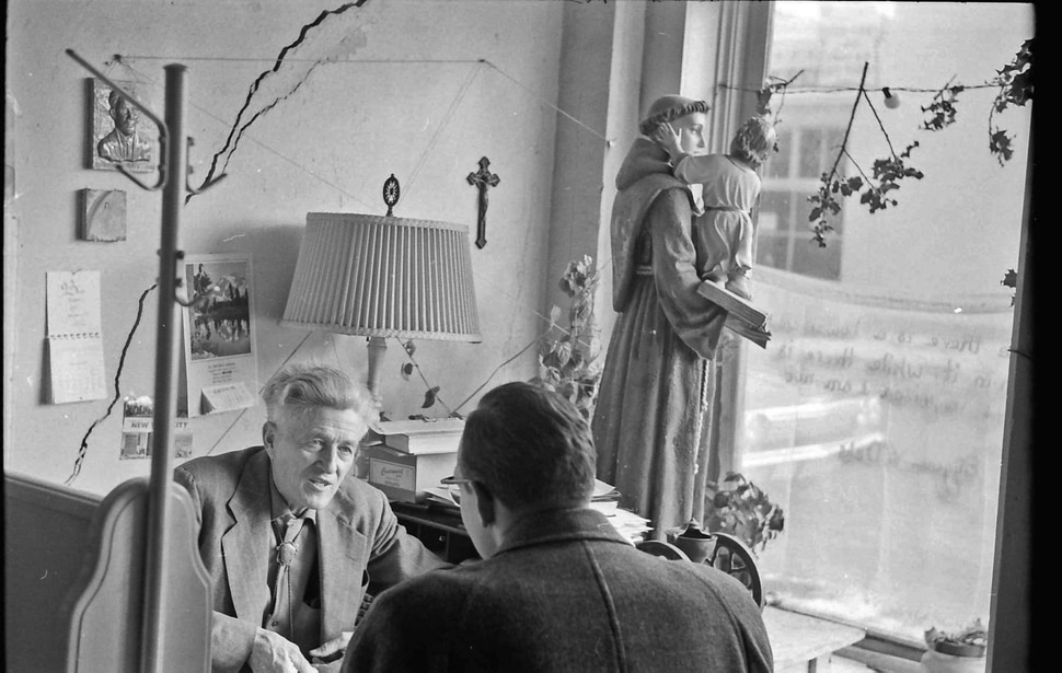 (photo courtesy Jerry Currier) Ammon Hennacy speaks to a visitor at the Joe Hill House of Hospitality in downtown Salt Lake City in 1961. The location opened its doors as a homeless shelter in Nov. 1961, serving up to 60 people a day free of charge.
