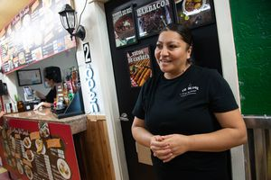 (Francisco Kjolseth  |  The Salt Lake Tribune) Cristina Olvera, owner of La Casa Del Tamal Mexican Restaurant, located inside the Azteca Bazaar in West Valley City, gets ready to start cooking.