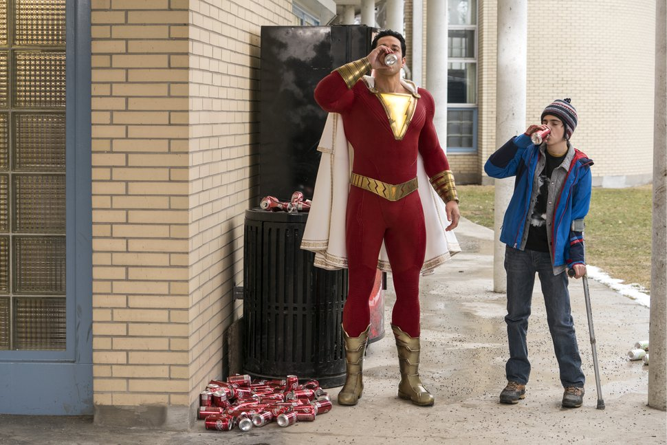 (Steve Wilkie | DC Comics/New Line Cinema/Warner Bros. Pictures) Superhero Shazam (Zachary Levi, left) and pal Freddy Freeman (Jack Dylan Grazer) have some soda in