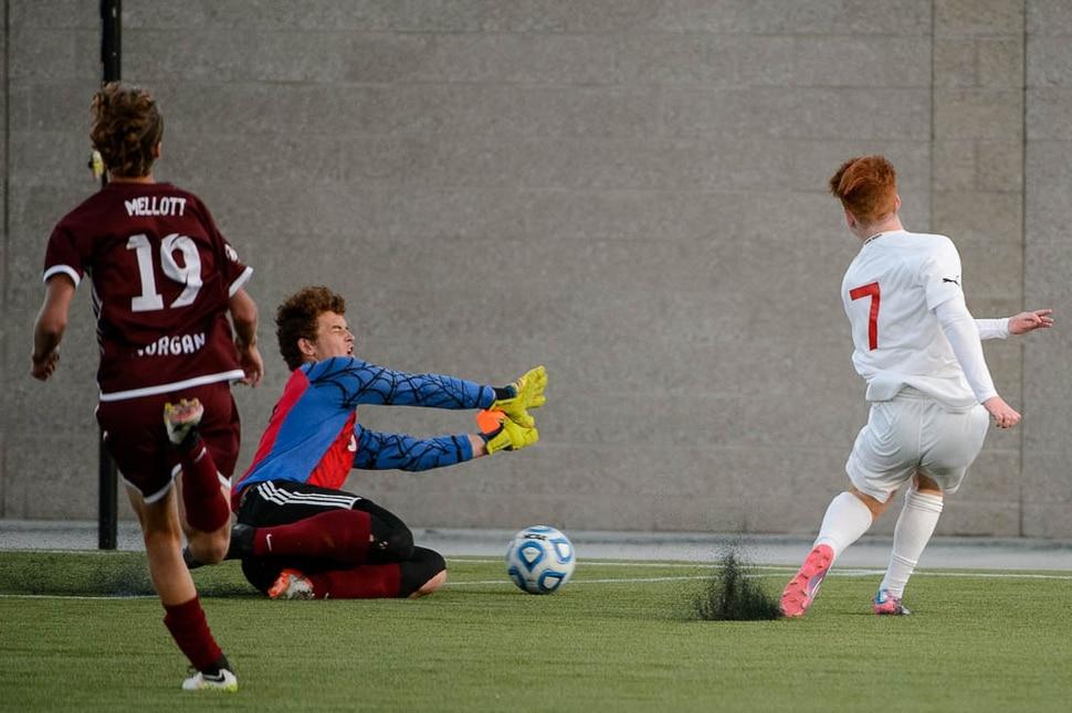 (Trent Nelson | The Salt Lake Tribune) Judge Memorial's Joseph Paul scores the game-winning goal against Morgan goalkeeper Trek Loveridge in the 3A state championship game, Saturday May 12, 2018.