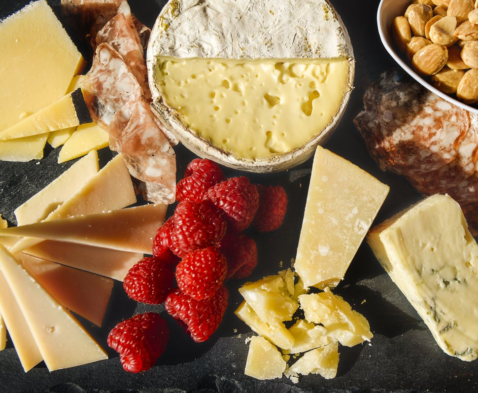 (Leah Hogsten | The Salt Lake Tribune) Each Harmons Grocery location has a cheesemonger who can recommend cheeses that would complement one another. From left, Lynher Dairies' Cornish Kern, Cypress Grove's Midnight Moon goat gouda, Jasper Hill Farm's Harbison, Caseificio La Madonnina's Parmigiano Reggiano and Rogue Creamery's Smokey Blue.