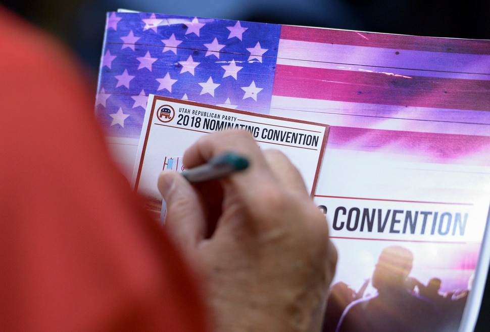 (Leah Hogsten | The Salt Lake Tribune) A state delegate casts his ballot at the Utah Republican Nominating Convention Friday, April 20, 2018 at the Maverick Center.