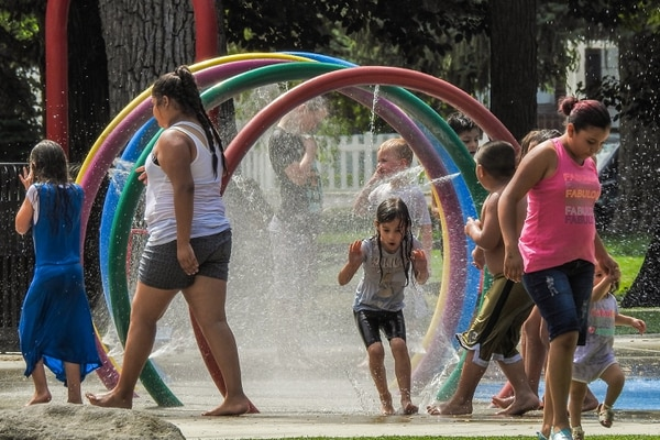 Chris Detrick   The Salt Lake Tribune Children play in the splash pad in Rotary Playground at Liberty Park Wednesday, July 12, 2017.