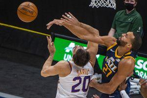 (Rick Egan | The Salt Lake Tribune) Utah Jazz center Rudy Gobert (27) blocks a shot by Phoenix Suns forward Dario Saric (20), in NBA action between the Utah Jazz and the Phoenix Suns, on Thursday, Dec. 31, 2020.