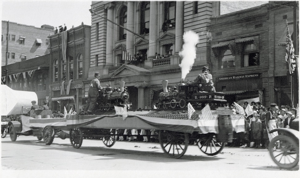 "(Photo courtesy Stewart Library, Special Collections) Miniature train engines are seen on a float in 1919 during a parade in Ogden to mark the 50th anniversary of the completion of the transcontinental railroad. Photographs taken during the parade are featured in Spike 50: Golden Spike Parade in 1919,"" a free exhibit at Union Station, 2501 Wall Ave., Ogden, through May 31."