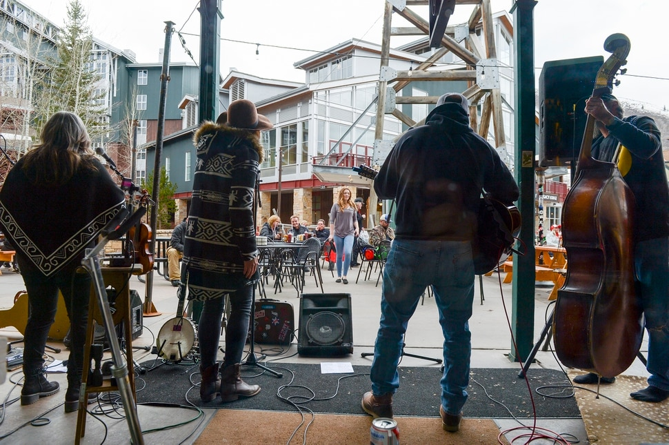 (Leah Hogsten | The Salt Lake Tribune) The band Lash LaRue plays outside The Corner Store at Park City Mountain Resort, Thursday, April 5, 2018. Despite the late arriving and limited snow this year, Utah ski resorts say they fared well because of snowmaking and the provision of side activities that helped ensure destination visitors had a good time while they were here, snow or no snow.